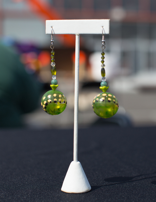 Green Glass Earrings with black, yellow and white dots